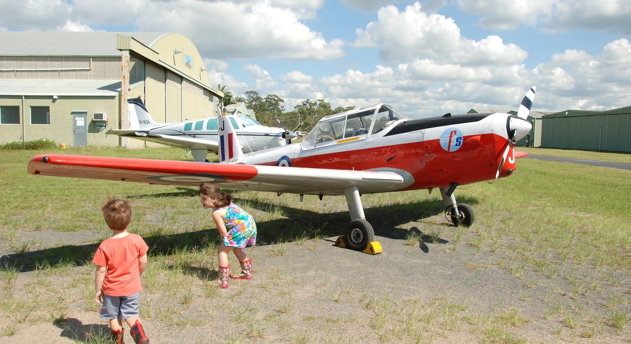 Caboolture Warplane Museum Red Plane On Field Kids Moreton Bay Region