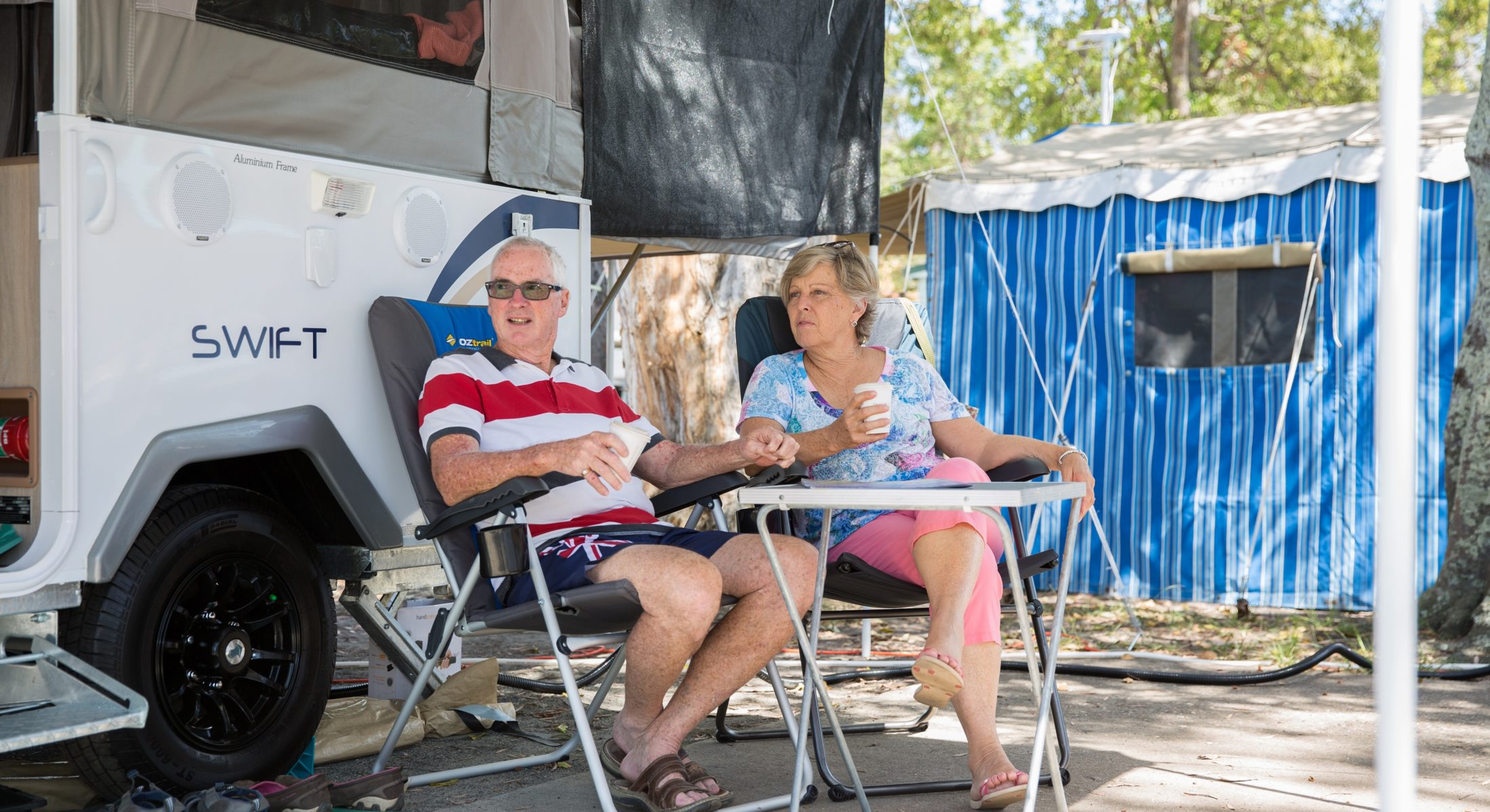 Couple With Caravan Camping Moreton Bay Region Morning Coffee