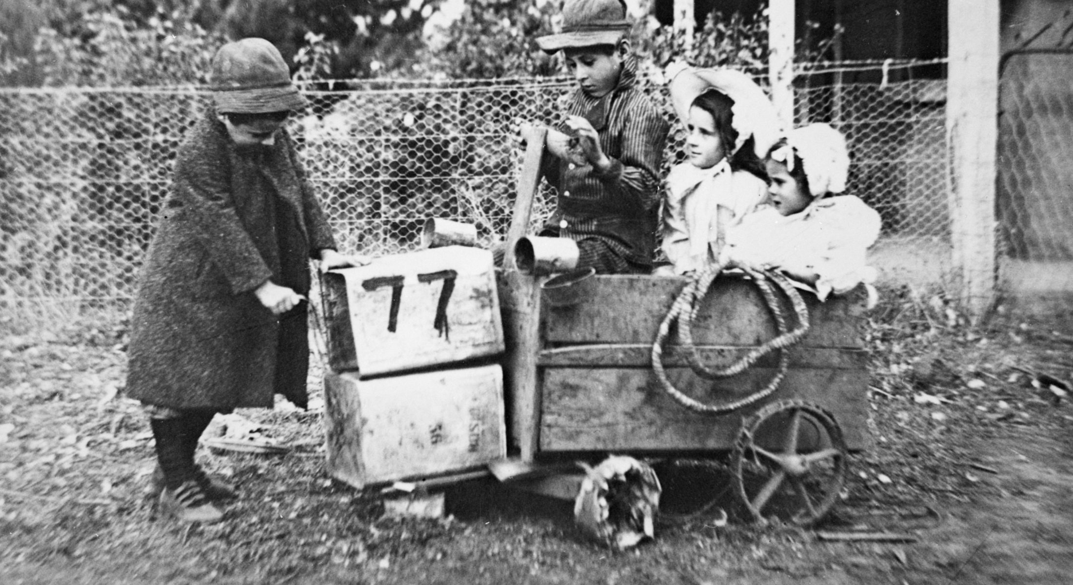 Children in billy cart made from packing cases and tin cans Victoria c1910 Museums Victoria